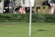 Luke Donald hits out of a sand trap on the 17th hole. Donald shot a third-round 67 on Saturday in Irving, Texas, to lead the Byron Nelson Championship by one stroke.