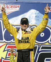 Bobby Labonte celebrates his victory in the Busch Series Aaron's 312. Labonte won Saturday in Talladega, Ala.
