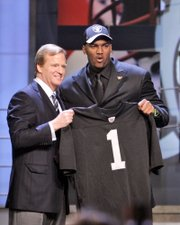 JAMARCUS RUSSELL, RIGHT, stands with NFL commissioner Roger Goodell after the Oakland Raiders made the quarterback out of LSU the top pick in the NFL Draft. The first three rounds of the draft were completed Saturday in New York.