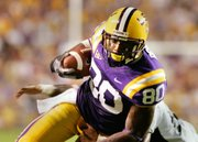 Louisiana State receiver Dwayne Bowe (80) tries to elude a Tulane defender last season. The Chiefs selected Bowe with the 23rd pick in the NFL Draft Saturday in New York.