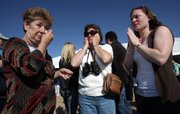 Jennifer Gorman, from left, with David Gorman's sister, Marilyn Larson and niece Eileen Whitesides attend the launch of a rocket carrying ashes from several people, including actor James Doohan and Jennifer's late husband, David Gorman, into space Saturday from Upham, N.M.