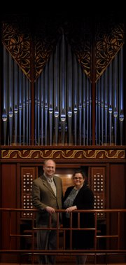Michael Bauer, professor of music and dance at Kansas University and wife Marie Rubis Bauer, director of music at Saint Cecilia Cathedral in Omaha, Nebraska, are pictured before the organ at Bales Organ Recital Hall, where they will be presenting half of a series of organ concerts in honor of the 300th anniversary of the death of German composer Dieterich Buxtehude.