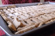 Organic biscottis cool on a cookie sheet after Victoria McDowell baked them in Jackson, Mo. McDowell owns Miss Autumn's Barkery, an organic pet food business.