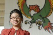 Free State High School senior Jing Li won a $2,500 scholarship from the National Merit Corp. Li, pictured Tuesday at FSHS, will attend the Massachusetts Institute of Technology in the fall.