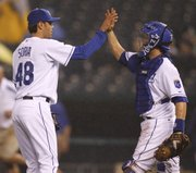 KANSAS CITY PITCHER JOAKIM SORIA, LEFT, and catcher Jason LaRue celebrate after the final out against the Los Angeles Angels. The Royals won, 3-1, Wednesday at Kauffman Stadium.