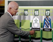 WINSTAR FARM PRESIDENT Bill Castner hangs the silks for his Kentucky Derby entrant, Any Given Saturday. The post position draw for the Derby was Wednesday in Louisville, Ky.