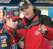 Jeff Gordon, left, confers with crew chief Steve Letarte during a February practice session at Daytona International Speedway.