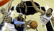Denver Nuggets guard Allen Iverson (3) is defended by San Antonio Spurs forward Tim Duncan, left, and forward Robert Horry (5) during the first quarter of their NBA first-round playoff game Wednesday in San Antonio.