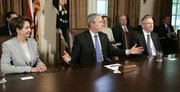 President Bush, center, flanked by House Speaker Nancy Pelosi, of California, left, and Senate Majority Leader Harry Reid, of Nevada, meets with congressional leaders regarding a new bill to fund the war in Iraq. Presidential adviser Karl Rove is seen seated behind Bush and Reid.