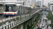 A Skytrain moves along elevated tracks Friday in downtown Bangkok, Thailand. International delegates to a global climate conference on Friday agreed that the world has the technology and money to limit catastrophic global warming, but that it must act now. Using public transportation such as Bangkok's Skytrain and subway system would help cut greenhouse gas emissions.