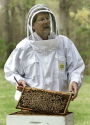 Jeff Pettis, the top bee scientist at the USDA's Bee Research Laboratory, is working to track down the mysterious killer that is threatening honeybees. About one-third of the human diet comes from insect-pollinated plants, and honeybees are responsible for handling 80 percent of their pollination, USDA says.