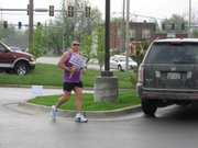 Karl Keltner takes off on one of his 26.2-mile runs. Keltner, from Liberty, Mo., plans to run 26 marathons in 26 days to raise awareness and funds for the Leukemia and Lymphoma Society. His seventh run will start today at the Lawrence Starbucks.