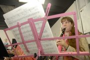 Emily Bachert rehearses with the Encore Home School Band during a recent practice at Hume Music, 711 W. 23rd Street.