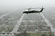 The Marine One helicopter, carrying President Bush, flies over the ruins of Greensburg Wednesday. Bush offered his condolences and federal assistance to tornado survivors.