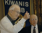 Al Gallup, left, gives onlookers a thumbs-up Thursday after receiving the Kiwanis Club's Substantial Citizen of the Year award. Gallup and Marilyn Dobski were honored with the award in recognition of their community service. Russell Mosser is at right.