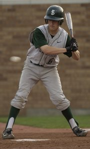 Lawrence Free State junior Jordan Dreiling watches a pitch from Lawrence High fly by at Hogland Ballpark on Thursday.