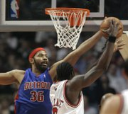 DETROIT'S RASHEED WALLACE BLOCKS A SHOT by Chicago's Ben Wallace during Game 3 of their second-round playoff series. The Pistons won, 81-74 on Thursday in Chicago to take a 3-0 series lead.