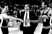 Providence coach Rick Pitino, center, stands between players Billy Donovan, left, and Delray Brooks as they congratulate each other after a Sweet 16 victory March 19, 1987. Pitino, now coach at Louisville, and Donovan, coach at Florida, plan to attend the reunion of the 1987 Providence Final Four team.