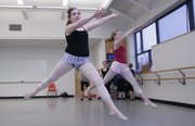 Rain Quinlan, 14, left, and classmate Maddie Backus, 13, practice leaps from one corner of a Lawrence Art Center dance studio to another during an Intermediate/Advanced Jazz Dance class.  Quinlan, who is home schooled, attends 13 hours of dance instruction each week.
