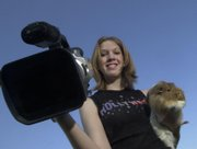 Alyssa Buecker poses with a guinea pig in this 2002 file photo. Buecker, who was home-schooled, gained national attention for her movies about guinea pigs.