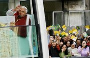 Pope Benedict XVI waves to the crowd from the popemobile in Sao Paulo, Brazil. The pope used an open-air Mass on Friday to stress the importance of sexual morality