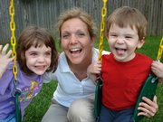 Erin Fagan, 4, left, and Max, 2, are the children of Susie and Mark Fagan, of Lawrence. The Fagans benefit from a lot of family support with two sets of grandparents in town.