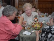 Pennie VonAchen, Eudora, left, and Arline Woosley, Baldwin City, enjoy a cup of tea and finger foods Saturday afternoon at the Mother's Day tea in memory of Elizabeth Miller Watkins. The event was from 2 p.m. to 4 p.m. at Watkins Community Museum of History, 1047 Mass.