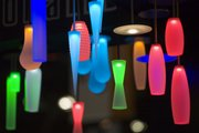 Colored lamps, illuminated by LEDs, are displayed by Winona Lighting at the Lightfair International trade show Tuesday in New York.