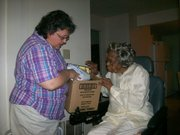 About 11:30 am, Janet delivered the commodities to senior, Christine Johnson.  Christine was thrilled to see Janet and was particularly excited that she got apple juice in the delivery.