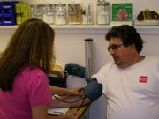 Health Care Access Clinic 11am - Manuela Ertmer, LPN takes patient Vince Bulgarelli's blood pressure during his visit to the Clinic.