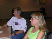 Lawrence Memorial Hospital 7:45 pm - Lawrence Half Marathon & 5k race directors Steve & Marcia Riley listen to volunteer feedback during a race wrap up meeting.  This benefit, our most successful and largest event to date, raised $42,000 for the Clinic.