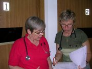 Health Care Access Clinic 10am - Mary Jane Miller, RN (left) and Susan Anderson, ARNP, our new Women's Health provider, discuss a patient's chart.