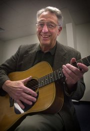 Patrick Bihlmaier, a drama therapist at St. Francis Academy in Salina, sometimes uses his guitar during the drama therapy classes. For the past two years Bihlmaier, 63, has conducted drama therapy sessions for at-risk adolescent boys.