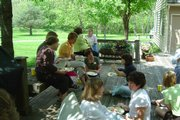 Deck shot: Tandy Reussner (left) and Sheryl Henry chat during lunch at the retreat