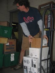 Tom Cottin, owner of Cottin's Hardware & Rental, unloads a truck full of stock early in the morning.