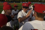 Lawrence High head coach Brad Stoll talks with his team May 10 before the game against Free State at Hogland Ballpark.