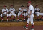 Lawrence High School head coach Brad Stoll pumps up his team before the game against Free State at Hogland Ballpark on Thursday, March 10.