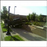 At about 8 a.m. today a pickup truck traveling east on Ninth Street between Kentucky and Vermont streets jumped the curb and ended up on top of a short brick fence