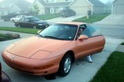 Paul Decelles' wife gets in her pumpkin-colored car to start the day's commute.