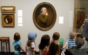 Preschoolers from the Lawrence Arts Center pause to examine Joseph Ducreux's painting 'Le Discret' (The Silence) as they tour the Spencer Museum of Art Wednesday at Kansas University. KU officials are talking with an Indianapolis-based developer about the possibility of a KU natural history and art museum in Olathe.