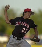 LAWRENCE HIGH'S DORIAN GREEN DELIVERS A PITCH during the championship game of the Class 6A regional against rival Free State. Green earned the win in Thursday's 8-1 victory.