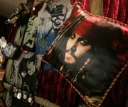 "The likeness of actor Johnny Depp appears on a pillow among ""Pirates of the Caribbean: At World&squot;s End"" merchandise displayed in Beverly Hills, Calif. The third chapter of the blockbuster film franchise is set to hit theaters Friday."