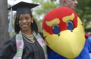 Miquela Bethel, Nassau, Bahamas, has her photo taken with Baby Jay at the chancellors reception for KU's graduating students. KU's 135th commencement ceremony was Sunday at Memorial Stadium.