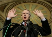 Senate Majority Leader Harry Reid of Nevada talks with reporters Tuesday on Capitol Hill in Washington, D.C., following debate on the Iraq war funding bill.