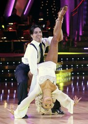 "This photo made available by ABC shows Apolo Anton Ohno and his partner, Julianne Hough, performing on ""Dancing With the Stars"" Monday in Los Angeles. Two-time Olympic gold medalist Ohno was named ""Dancing With the Stars"" champion Tuesday. The speed skater and Hough beat out former &squot;N Sync star Joey Fatone to win the ABC dance-off&squot;s mirror-ball trophy."