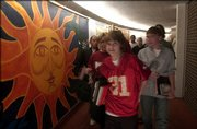 South Junior High School students pass the halls between classes, where one wall is adorned with a sun-motif mural, in this 2006 file photo. The walls, and their artwork, will come down this summer as the junior high building is replaced.