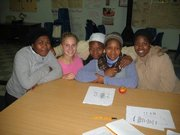 Jessie Funk, Kansas University senior in women's studies, second from left, is shown with students she worked with during her study abroad term in South Africa.