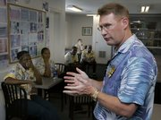 Keith Overton, chief operating officer of Tradewinds Islands Resorts, speaks to some of his employees Tuesday in St. Petersburg Beach, Fla. Overton said the two beachfront resorts he manages on Florida's west coast couldn't stay open without its 100 or so seasonal workers. Tradewinds Islands Resorts now gets most of its foreign workers through an agency that hires them on temporary visas from Jamaica and Thailand. They work as housekeepers, cooks and maintenance engineers.