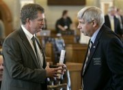 Rep. Dennis McKinney, D-Greensburg, left, talks with Rep. Ron Worley, R-Lenexa. The Legislature approved relief funding for the tornado that leveled most of Greensburg, including McKinney's home.