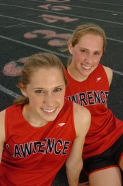 LAWRENCE HIGH TWIN SISTERS KRISTINA TAYLOR, LEFT, and Jennifer Taylor will each compete in three events at this weekend's Class 6A state track meet in Wichita.